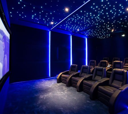 A beautifully setup home cinema in dubai with blue color