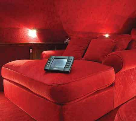 A fully automated cinema with red interior by Stallion Vision